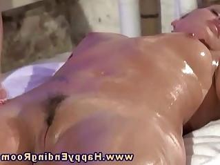 Lesbian fingering during her massage of a hot model